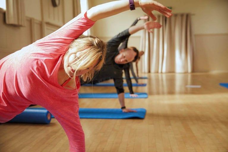 Online pilates video showing side bend