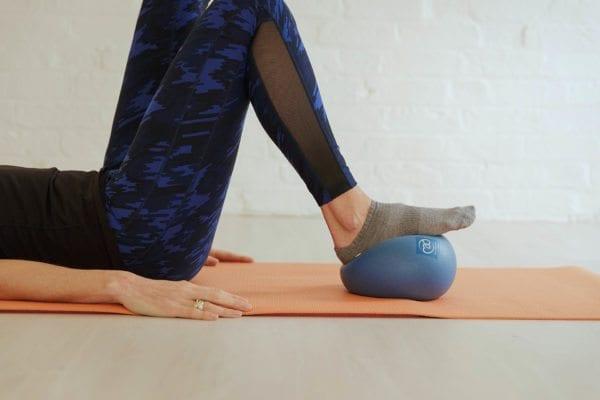 Benefits of using the Mini Ball in Pilates - Studio 44 Pilates
