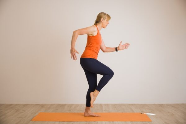 Louise Humphrey demonstrating running man and balance a Pilates for Runners move